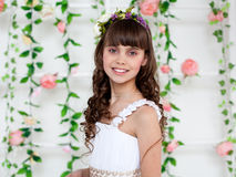 Portrait of a young beautiful  girl in a flower wreath. Teenagers. Portrait of a young beautiful  girl in a flower wreath Royalty Free Stock Photography