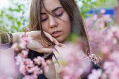 Portrait of young beautiful girl in flowers Royalty Free Stock Photo