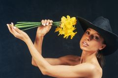 Portrait of a young beautiful girl with flowers in the Studio royalty free stock images