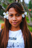 Portrait of young beautiful girl with the frangipani, plumeria flowers on her hair Royalty Free Stock Images