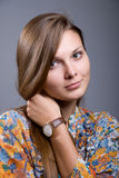 Portrait of a young beautiful girl with hand clock Stock Photo