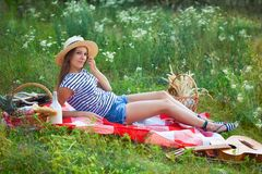 Portrait of a young beautiful girl on a picnic in the forest stock photos