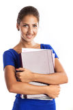 Portrait of a young beautiful girl holding files Royalty Free Stock Image