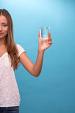 Portrait of young beautiful girl holding a glass Royalty Free Stock Images