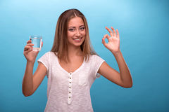 Portrait of young beautiful girl holding a glass Royalty Free Stock Photo