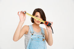 Portrait of young beautiful girl, holding tape measure Royalty Free Stock Photo