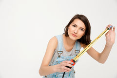 Portrait of young beautiful girl, holding tape measure Royalty Free Stock Photography