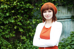 Portrait of a young beautiful girl in an knitted beret Royalty Free Stock Image