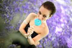 Portrait young beautiful girl with lollipop candy.  Stock Image