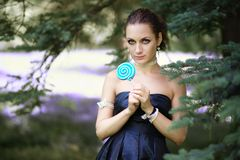 Portrait young beautiful girl with lollipop candy.  Stock Photography