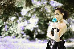 Portrait young beautiful girl with lollipop candy.  Royalty Free Stock Photography