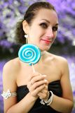 Portrait young beautiful girl with lollipop candy Royalty Free Stock Photography