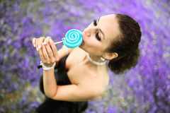 Portrait young beautiful girl with lollipop candy.  Royalty Free Stock Images