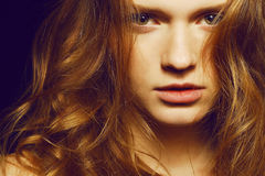 Portrait of young beautiful girl with long ginger hair Stock Images