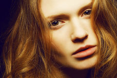 Portrait of young beautiful girl with long ginger hair Royalty Free Stock Photo