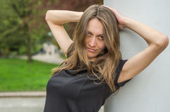 Portrait of a young beautiful girl with long hair while walking in the park stock image