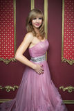 Portrait of young beautiful girl in long pink dress Royalty Free Stock Photo