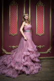 Portrait of young beautiful girl in long pink dress Stock Photo