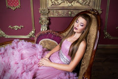 Portrait of young beautiful girl in long pink dress Stock Photography