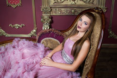 Portrait of young beautiful girl in long pink dress Royalty Free Stock Image