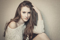 Portrait of young beautiful girl looking at camera, playful look Royalty Free Stock Images