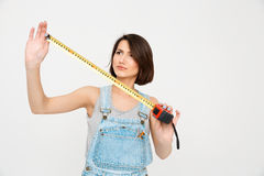 Portrait of young beautiful girl , looking on the tape measure Stock Images