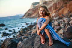Portrait of young and beautiful girl in Oia. Royalty Free Stock Photo