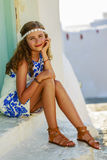 Portrait of young and beautiful girl in Oia. Stock Photography