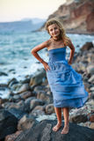 Portrait of young and beautiful girl in Oia. Stock Photo