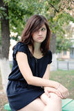 Portrait of a young beautiful girl in a park Royalty Free Stock Photography