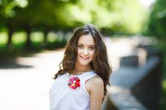 Portrait of young beautiful girl in a park Stock Photos