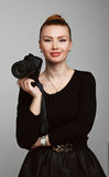 Portrait of a young beautiful girl photographer with his camera. Royalty Free Stock Image
