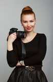 Portrait of a young beautiful girl photographer with his camera. Royalty Free Stock Photo