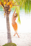 Portrait young beautiful girl relaxing on beach. Smiling woman spending chill time outdoor Bali island. Summer Season Royalty Free Stock Image