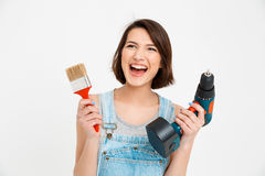 Portrait of young beautiful girl, screaming, holding painting Stock Photos