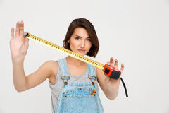Portrait of young beautiful girl, showing tape measure Stock Photos