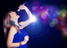 Portrait of young beautiful girl singing Stock Photos
