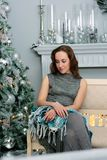 Portrait of young and beautiful girl sitting at sofa during christmas celebration - christmas and new year concept stock photos
