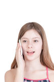 Portrait of the young beautiful girl speaking by phone Stock Photography