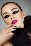Portrait of young beautiful girl with stage make-up Royalty Free Stock Image