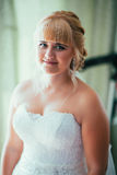 Portrait of young beautiful happy bride near the window Royalty Free Stock Photos