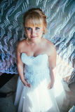 Portrait of young beautiful happy bride near the window Royalty Free Stock Images