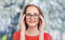 Portrait of young beautiful happy girl in glasses Stock Photography