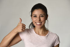 Portrait of young beautiful and happy Latin woman with big toothy smile excited and cheerful. In charming face expression giving hand ok sign isolated clear Stock Photos
