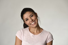 Portrait of young beautiful and happy Latin woman with big toothy smile excited and cheerful Stock Photos