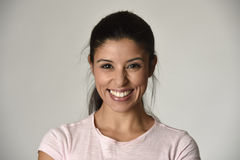 Portrait of young beautiful and happy Latin woman with big toothy smile excited and cheerful. In charming face expression isolated clear grey background in Royalty Free Stock Image