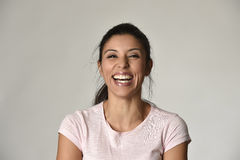 Portrait of young beautiful and happy Latin woman with big toothy smile excited and cheerful Royalty Free Stock Image