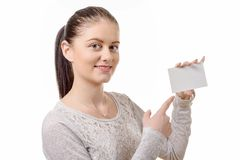 Portrait of  young beautiful happy woman with blank white card Stock Photography
