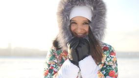 Portrait of young beautiful happy woman outdoors enjoying winter day looking into the camera Stock Images