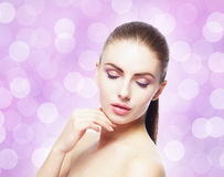 Portrait of young, beautiful and healthy woman: over pink backgr. Ound. Healthcare, spa, makeup and face lifting concept Stock Photos